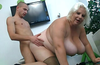 Huge tits blonde lady gets doggystyled
