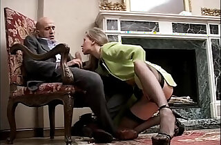 Classy and sexy black girl in high heels and stockings sucking cock