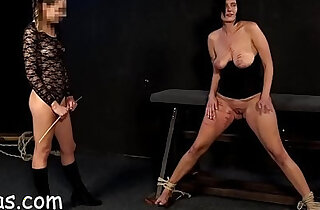 Young dominatrix punishes girl masturbate with tits