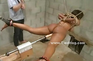 Nasty with ponytail slapping naked sex slave tied like a hog in ropes