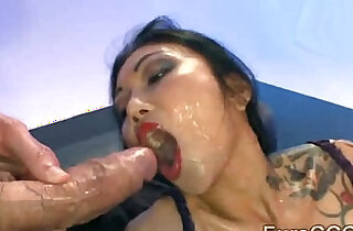 Tattooed Asian whore is disgraced in nasty gang bang